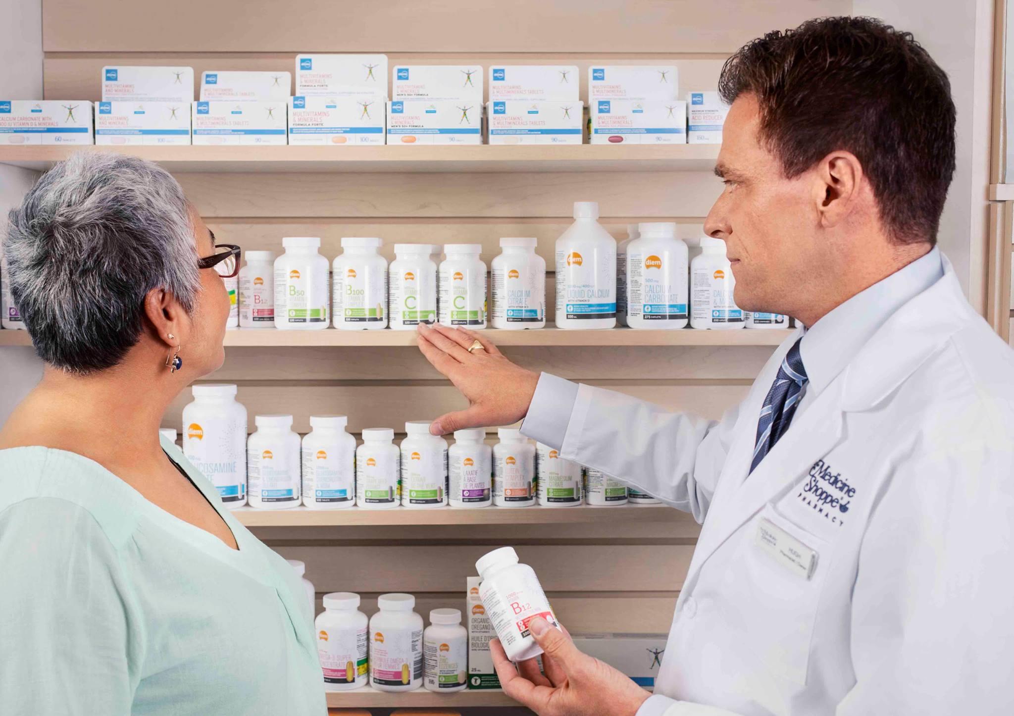 pharmacist assisting woman awareness